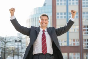 A Successful Business Man Excited About Recovery Month