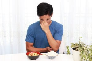Young Man Struggling With An Eating Disorder