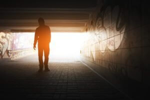 A Man Walking Into The Light To Dispel Recovery Myths