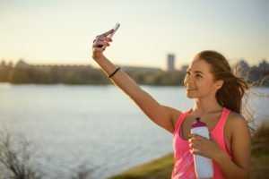 A Girl Taking A Selfie Representing Staying Sober