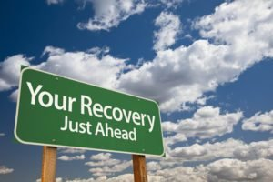 Sign Saying Recovery And Sobriety Lay Just Ahead