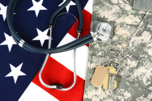 A Stethoscope On An American Flag And Military Uniform Representing Substance Abuse In The Military