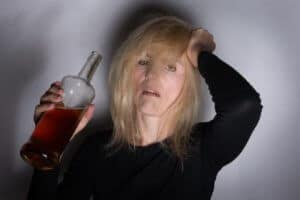 Alcoholic Woman Who Is Dealing With Chronic Mental Illness