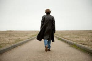 A Man Walking Down The Highway Saying Goodbye To The Things He Won't Miss About Drinking