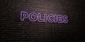 The Word Policies On A Neon Sign Representing Advertising Policies