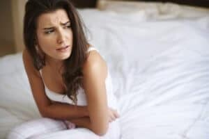 A Young Woman Suffering Nausea And Other Effects Of Using Alcohol While Taking Disulfiram