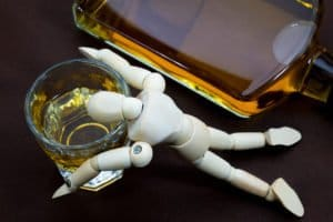A Dummy Lying Facedown In A Shot Representing Someone Suffering From Alcohol Poisoning